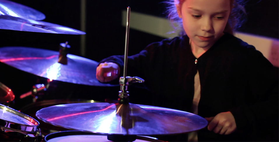 girl practising drums